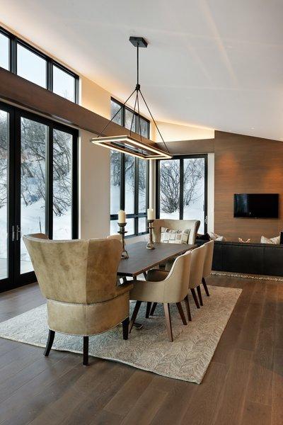 Modern home with dining room, chair, table, pendant lighting, and medium hardwood floor. Photo 8 of Saddleback Lane