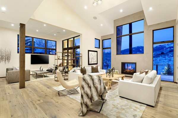 Modern home with living room, chair, medium hardwood floor, coffee tables, sofa, two-sided fireplace, and recessed lighting. Photo 3 of Mustang Circle