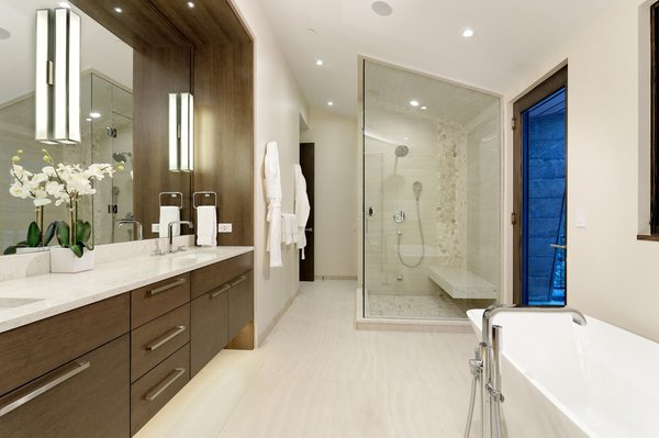 Modern home with bath room, corner shower, undermount sink, freestanding tub, wall lighting, and ceiling lighting. Photo 12 of Mustang Circle