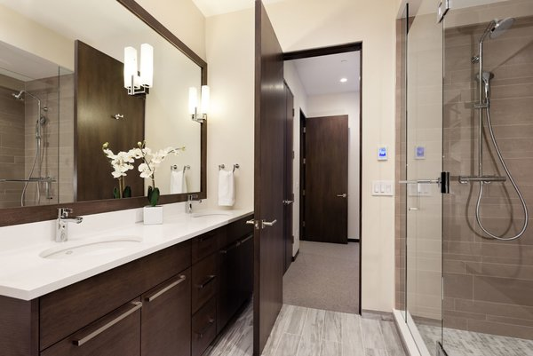 Modern home with bath room, undermount sink, corner shower, and wall lighting. Photo 14 of Mustang Circle