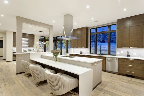 Modern home with kitchen, medium hardwood floor, wood cabinet, and recessed lighting. Photo 7 of Mustang Circle