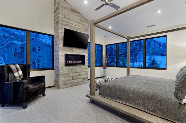 Modern home with ribbon fireplace, bedroom, ceiling lighting, recessed lighting, and bed. Photo 11 of Mustang Circle