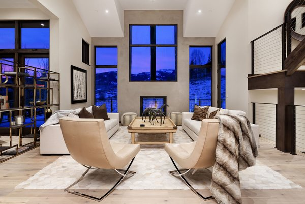 Modern home with living room, sofa, chair, recessed lighting, shelves, medium hardwood floor, and two-sided fireplace. Photo 6 of Mustang Circle