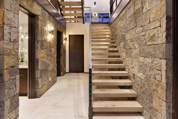 Modern home with wood tread, metal railing, and hallway. Photo 13 of Mustang Circle