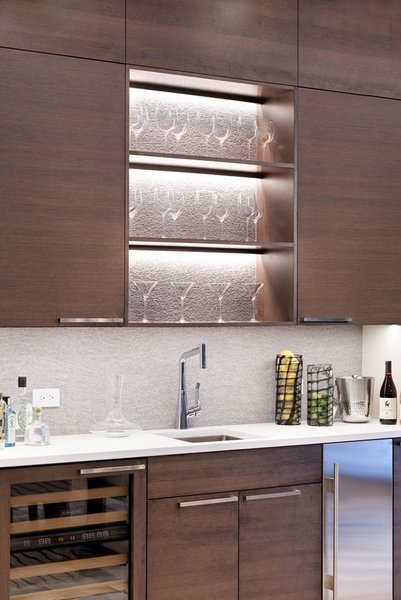 Modern home with wine cooler, beverage center, wood cabinet, and dining room. Photo 10 of Mustang Circle