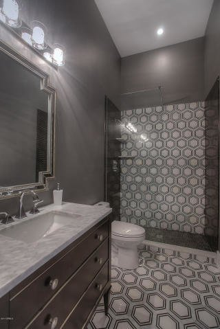 Modern home with bath room, ceramic tile floor, open shower, undermount sink, marble counter, full shower, recessed lighting, pendant lighting, and one piece toilet. Fanfol Bathroom Photo 7 of Fanfol House