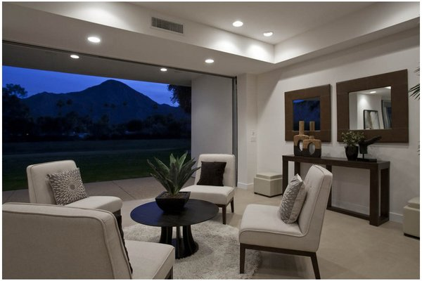 Modern home with living room, recessed lighting, and chair. Photo  of The Fairway House