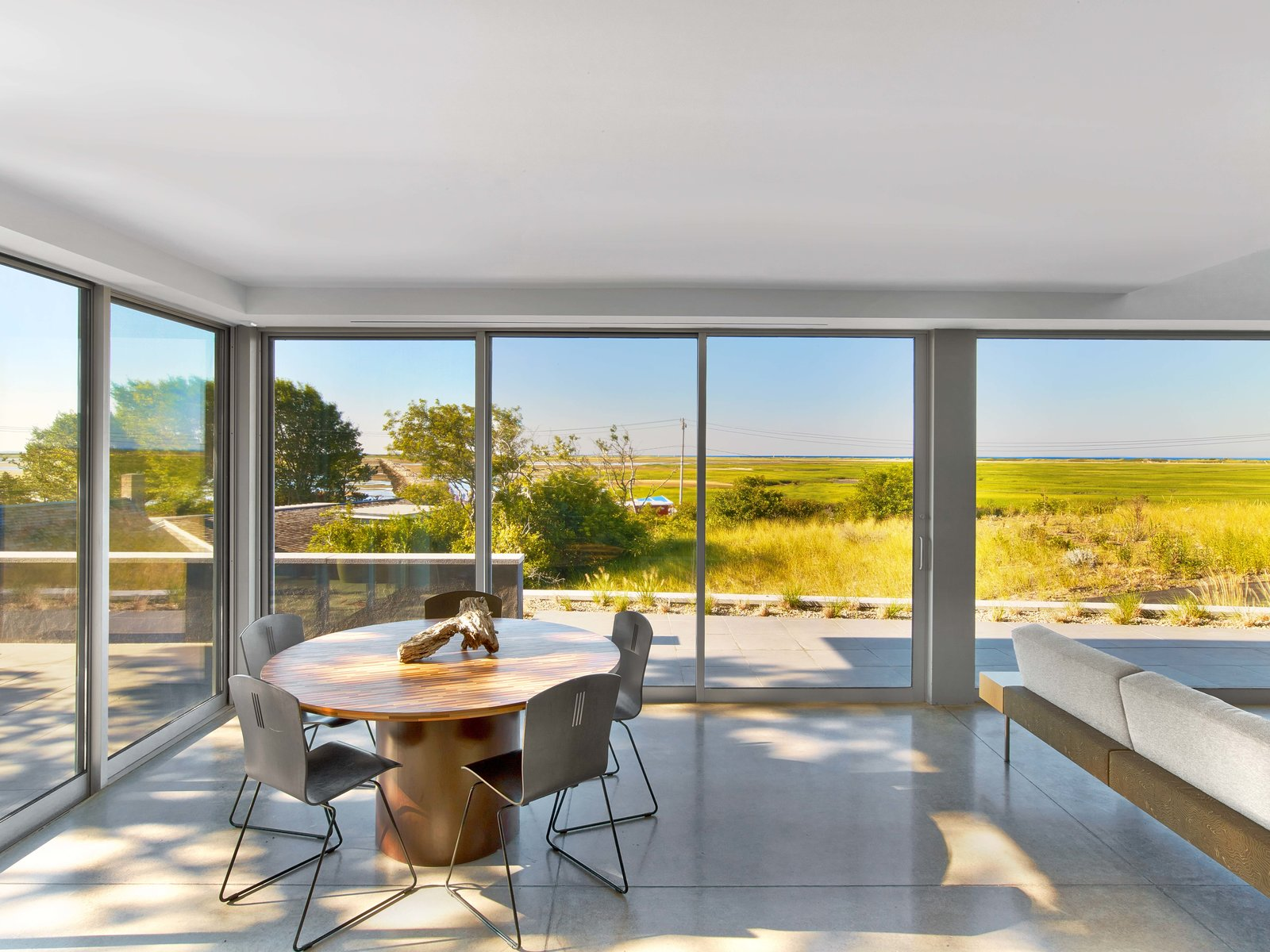 Tagged: Dining Room, Table, Chair, and Concrete Floor.  Cape Cod - Beach House by Hariri & Hariri Architecture