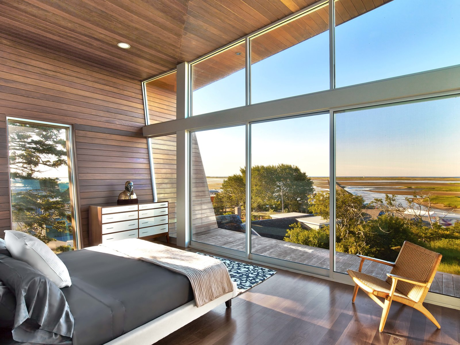 Tagged: Bedroom, Ceiling Lighting, Chair, Bed, Dresser, and Medium Hardwood Floor.  Cape Cod - Beach House by Hariri & Hariri Architecture
