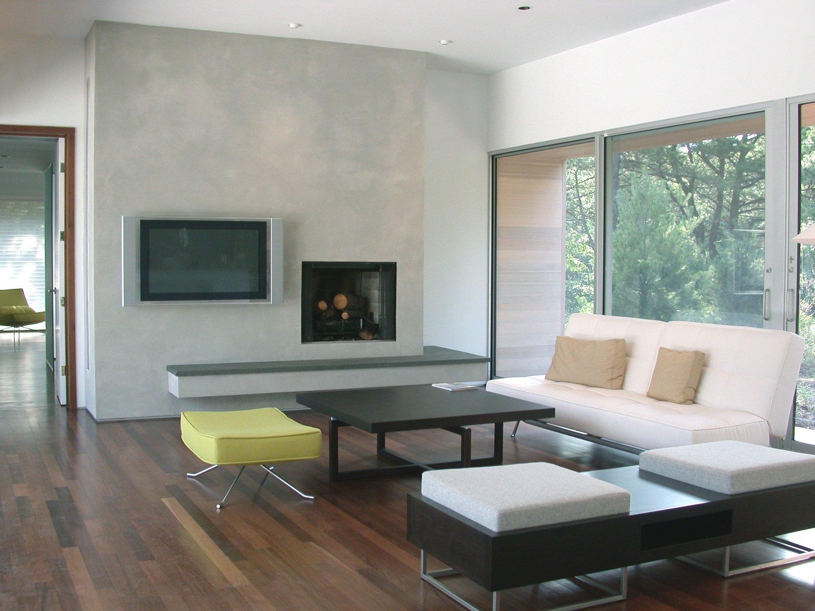 Tagged: Living Room, Sofa, Ceiling Lighting, Coffee Tables, Wood Burning Fireplace, Medium Hardwood Floor, and Chair.  Sagaponac House by Hariri & Hariri Architecture