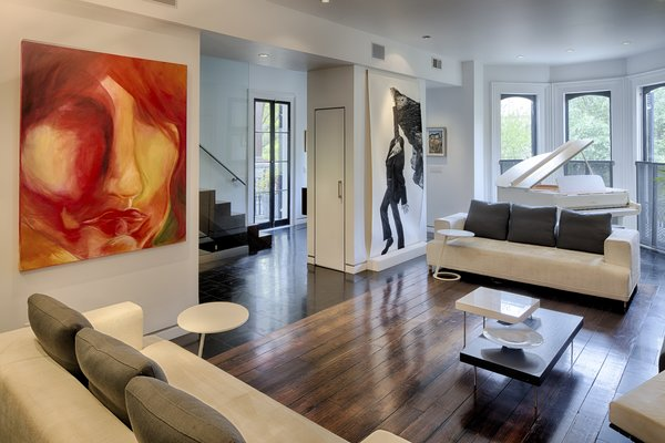 Modern home with living room, recessed lighting, coffee tables, sofa, and end tables. Photo  of 112 West Gaston Street