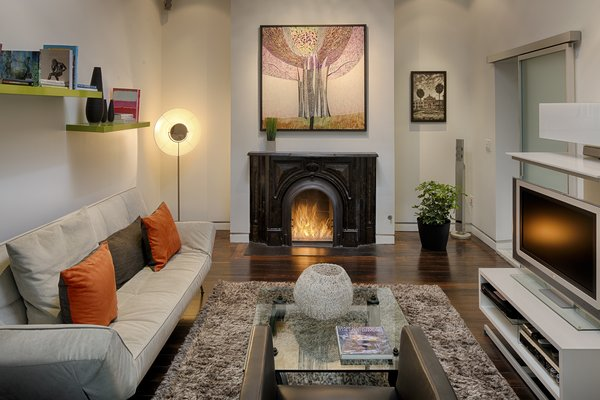Modern home with living room, sofa, coffee tables, and gas burning fireplace. Photo 5 of 112 West Gaston Street