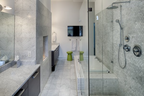 Modern home with bath room, marble counter, enclosed shower, soaking tub, and marble wall. Photo 6 of 112 West Gaston Street