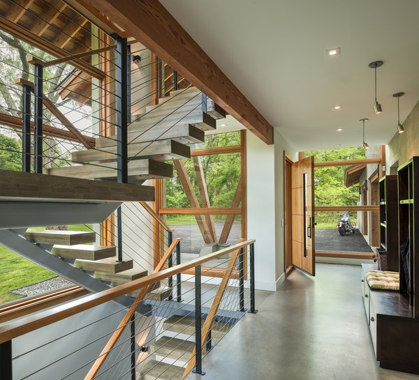 Modern home with staircase, wood tread, and metal railing. Photo 6 of Leaning Timber House
