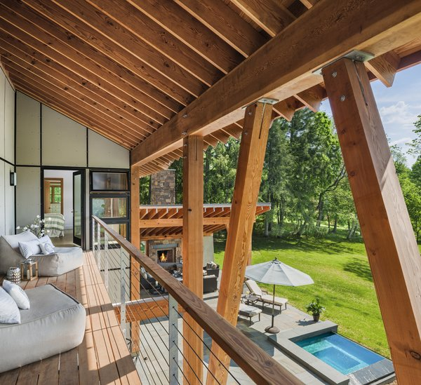 Modern home with outdoor, back yard, grass, small pool, large patio, porch, deck, and stone patio, porch, deck. Photo 3 of Leaning Timber House