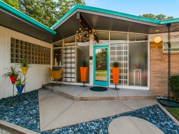 Modern home with exterior, swing door type, outdoor, and front yard. Photo 3 of Candy-Colored Mid-Century Modern Throwback