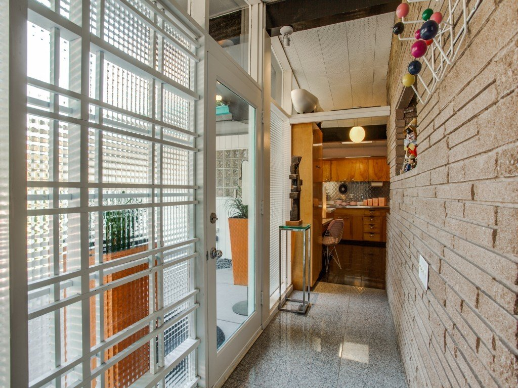 Tagged: Hallway and Limestone Floor.  Candy-Colored Mid-Century Modern Throwback by Zillow