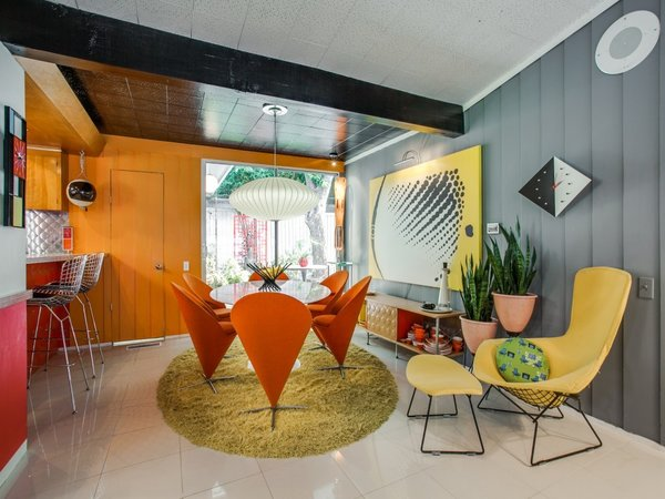 Modern home with dining room, table, ceiling lighting, ceramic tile floor, and chair. Photo 8 of Candy-Colored Mid-Century Modern Throwback