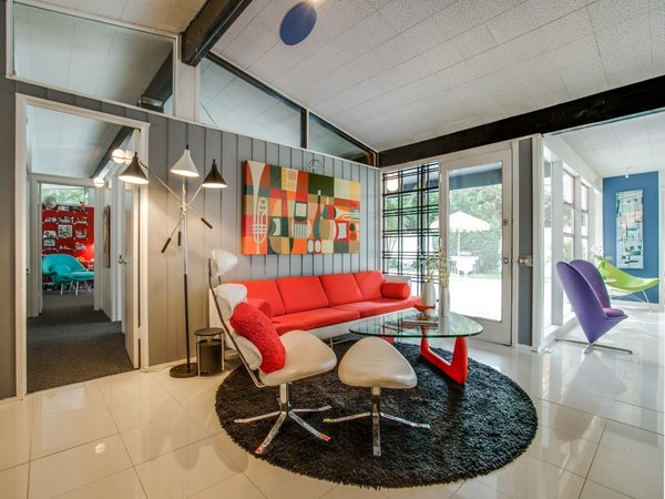 Modern home with living room, sofa, and chair. Photo 7 of Candy-Colored Mid-Century Modern Throwback