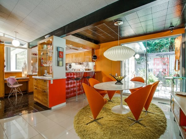 Modern home with wood cabinet, ceiling lighting, dining room, table, and chair. Photo 9 of Candy-Colored Mid-Century Modern Throwback