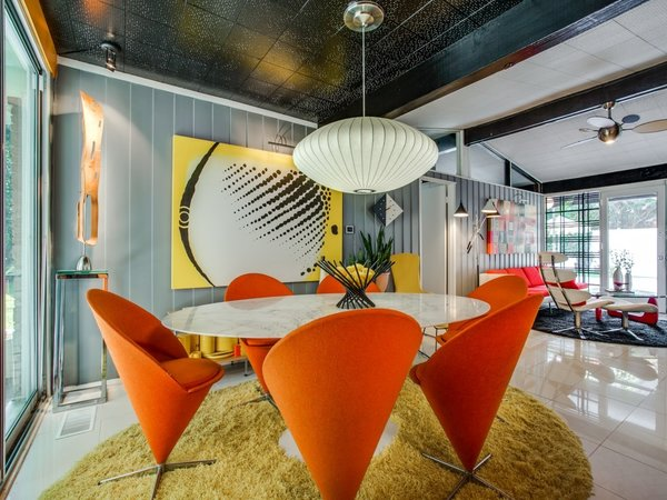 Modern home with dining room, ceramic tile floor, ceiling lighting, chair, and table. Photo 10 of Candy-Colored Mid-Century Modern Throwback