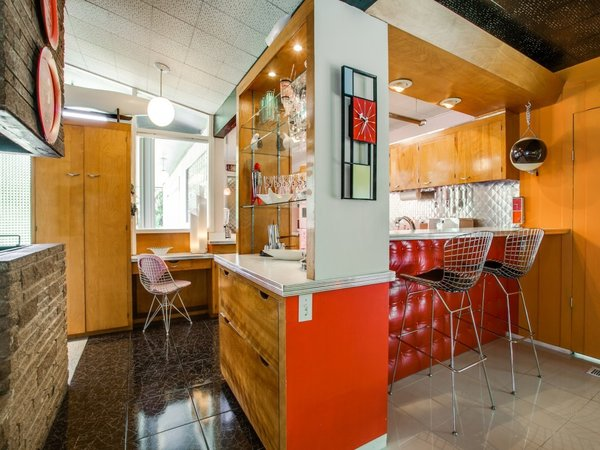 Modern home with kitchen, metal backsplashe, and wood cabinet. Photo 11 of Candy-Colored Mid-Century Modern Throwback
