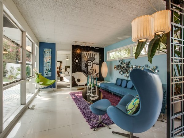 Modern home with living room, chair, porcelain tile floor, end tables, and coffee tables. Photo 16 of Candy-Colored Mid-Century Modern Throwback