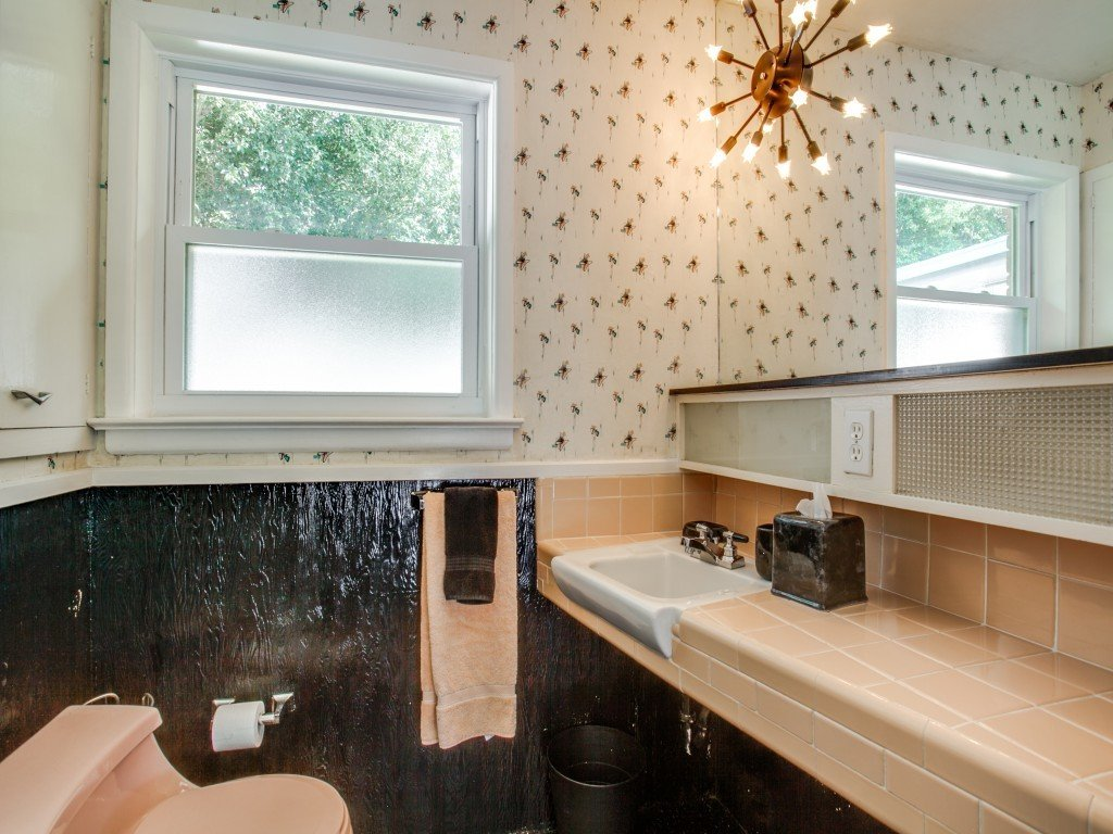 Tagged: Bath Room, Tile Counter, Two Piece Toilet, Pendant Lighting, and Drop In Sink.  Candy-Colored Mid-Century Modern Throwback by Zillow