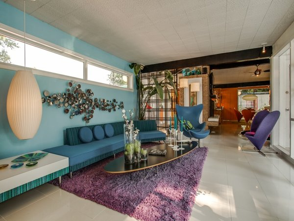 Modern home with living room, end tables, chair, sofa, sectional, and pendant lighting. Photo 17 of Candy-Colored Mid-Century Modern Throwback