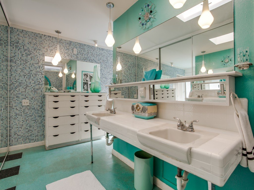 Tagged: Bath Room, Wall Mount Sink, Pendant Lighting, Linoleum Floor, and Mosaic Tile Wall. Candy-Colored Mid-Century Modern Throwback by Zillow