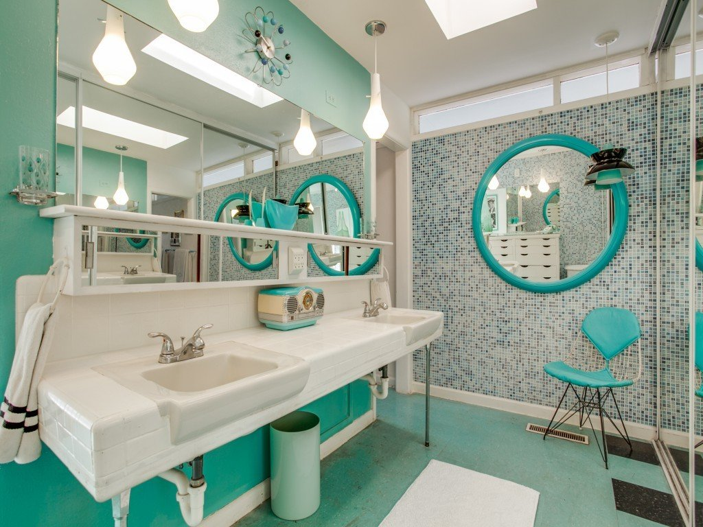 Tagged: Bath Room, Linoleum Floor, Pendant Lighting, Wall Mount Sink, and Mosaic Tile Wall.  Candy-Colored Mid-Century Modern Throwback by Zillow