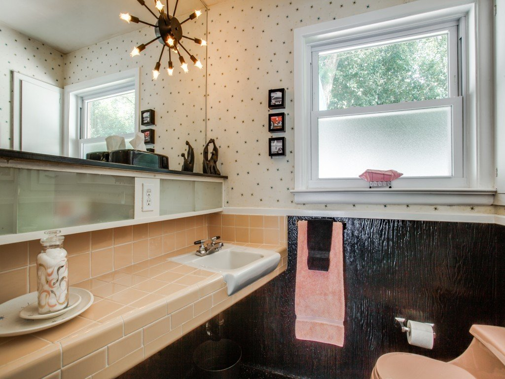 Tagged: Bath Room, Two Piece Toilet, Drop In Sink, Tile Counter, and Pendant Lighting.  Candy-Colored Mid-Century Modern Throwback by Zillow