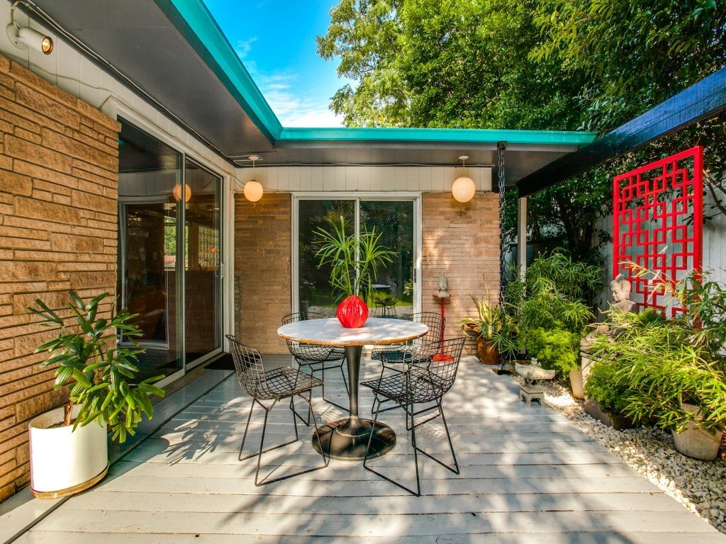 Tagged: Outdoor, Side Yard, Small Patio, Porch, Deck, Shrubs, and Wood Patio, Porch, Deck.  Candy-Colored Mid-Century Modern Throwback by Zillow