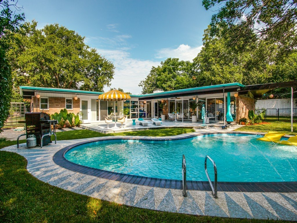 Tagged: Outdoor, Trees, Back Yard, Swimming Pools, Tubs, Shower, Large Pools, Tubs, Shower, Vertical Fences, Wall, Large Patio, Porch, Deck, Wood Patio, Porch, Deck, and Wood Fences, Wall.  Candy-Colored Mid-Century Modern Throwback by Zillow
