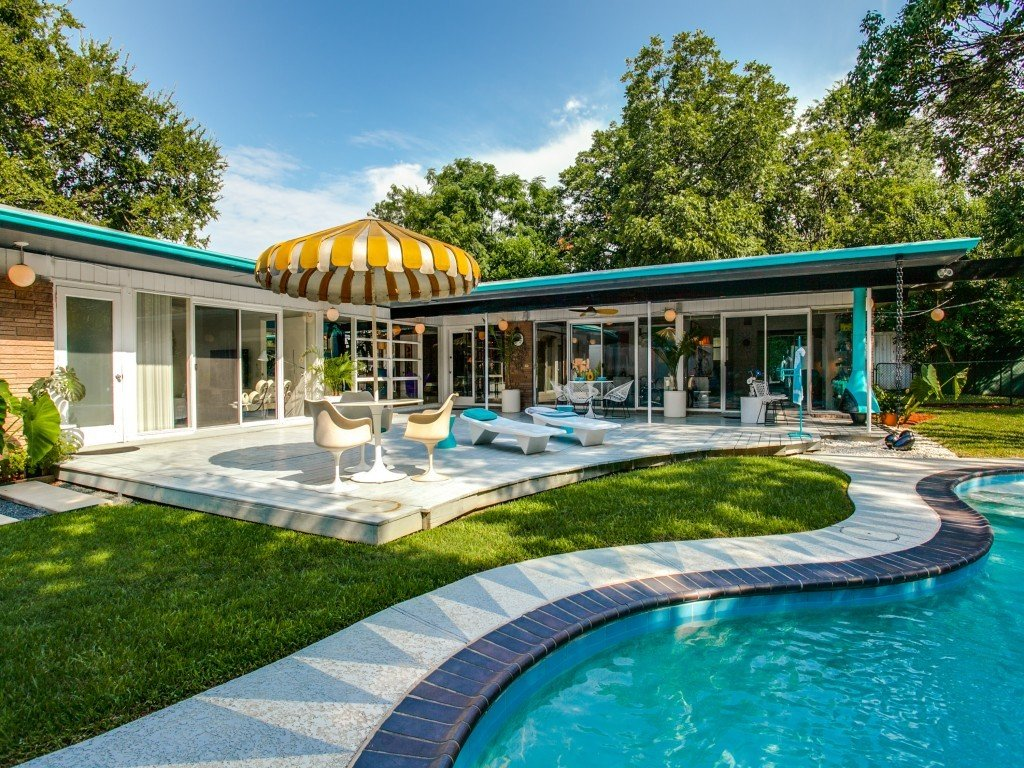 Tagged: Outdoor, Grass, Back Yard, Trees, Large Pools, Tubs, Shower, Wood Patio, Porch, Deck, Swimming Pools, Tubs, Shower, and Large Patio, Porch, Deck.  Candy-Colored Mid-Century Modern Throwback by Zillow