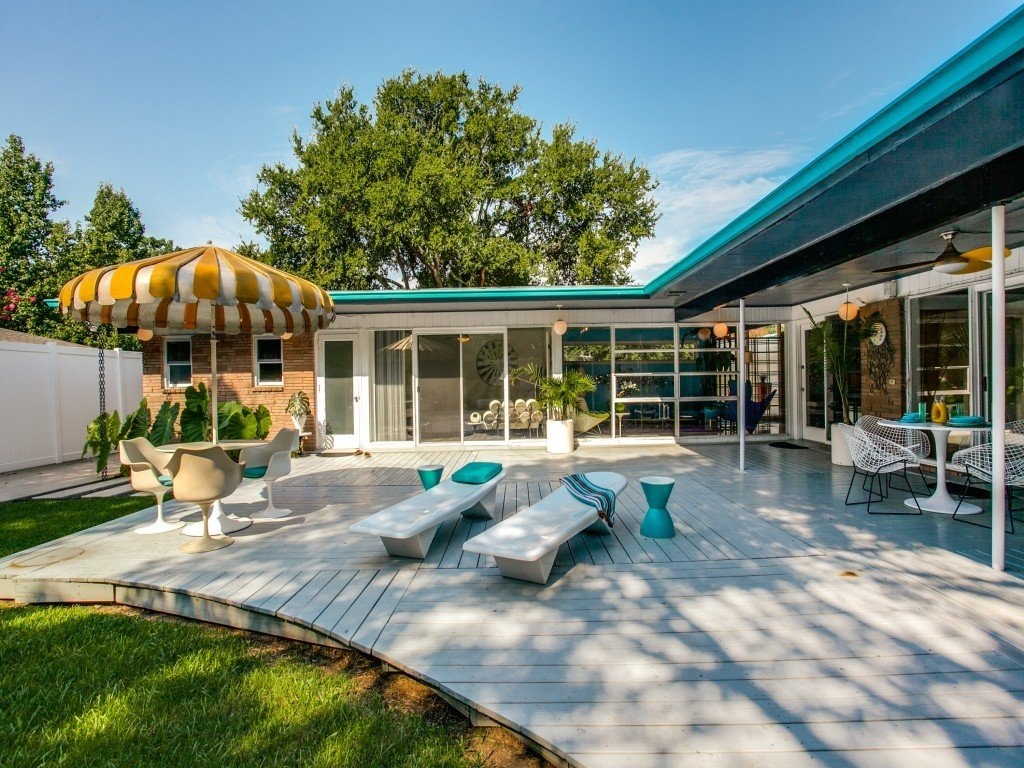 Tagged: Outdoor, Trees, Back Yard, Large Patio, Porch, Deck, and Wood Patio, Porch, Deck.  Candy-Colored Mid-Century Modern Throwback by Zillow