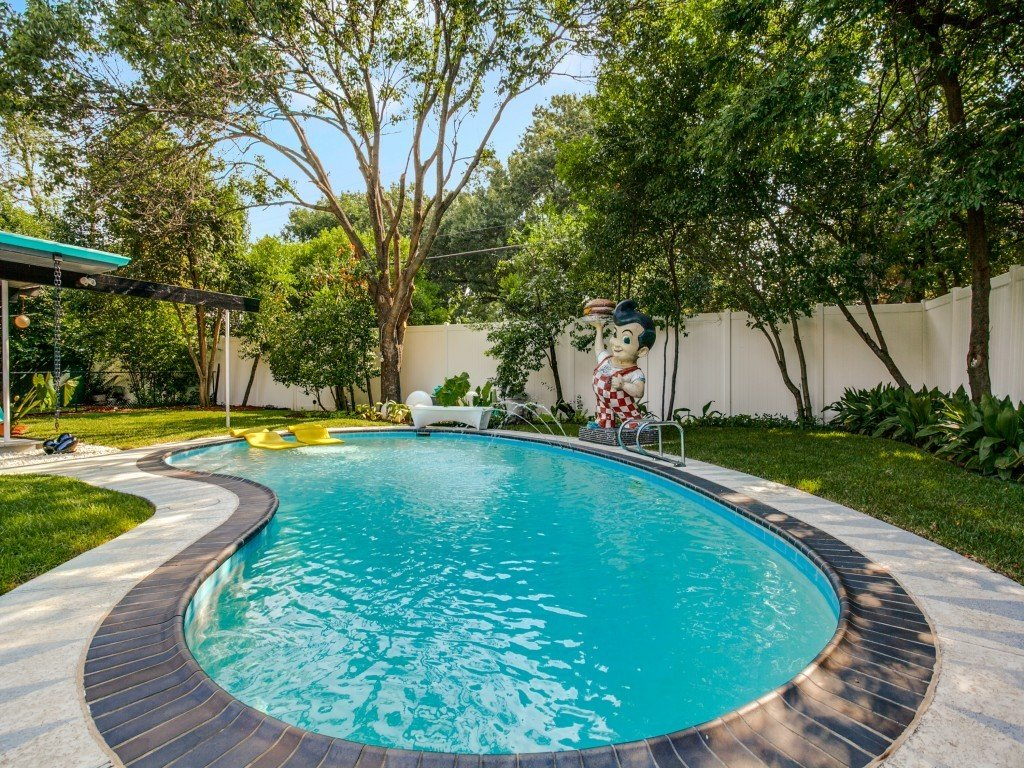Tagged: Outdoor, Back Yard, Trees, Large Pools, Tubs, Shower, Swimming Pools, Tubs, Shower, Vertical Fences, Wall, and Wood Fences, Wall.  Candy-Colored Mid-Century Modern Throwback by Zillow