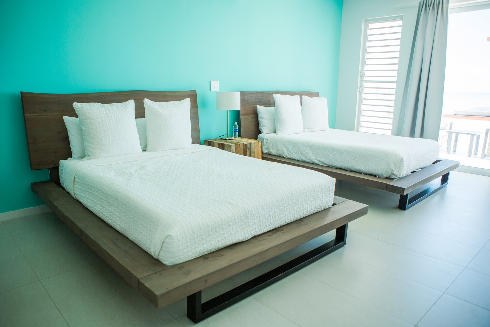 Tagged: Bedroom, Porcelain Tile Floor, Night Stands, Lamps, and Bed.  Tip of the Tail Villa by Zillow