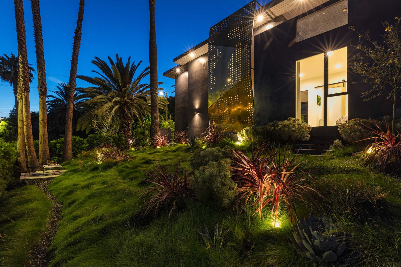 Tagged: Outdoor, Gardens, Slope, Front Yard, Trees, Walkways, and Grass.  Italian Modernist Home by Zillow