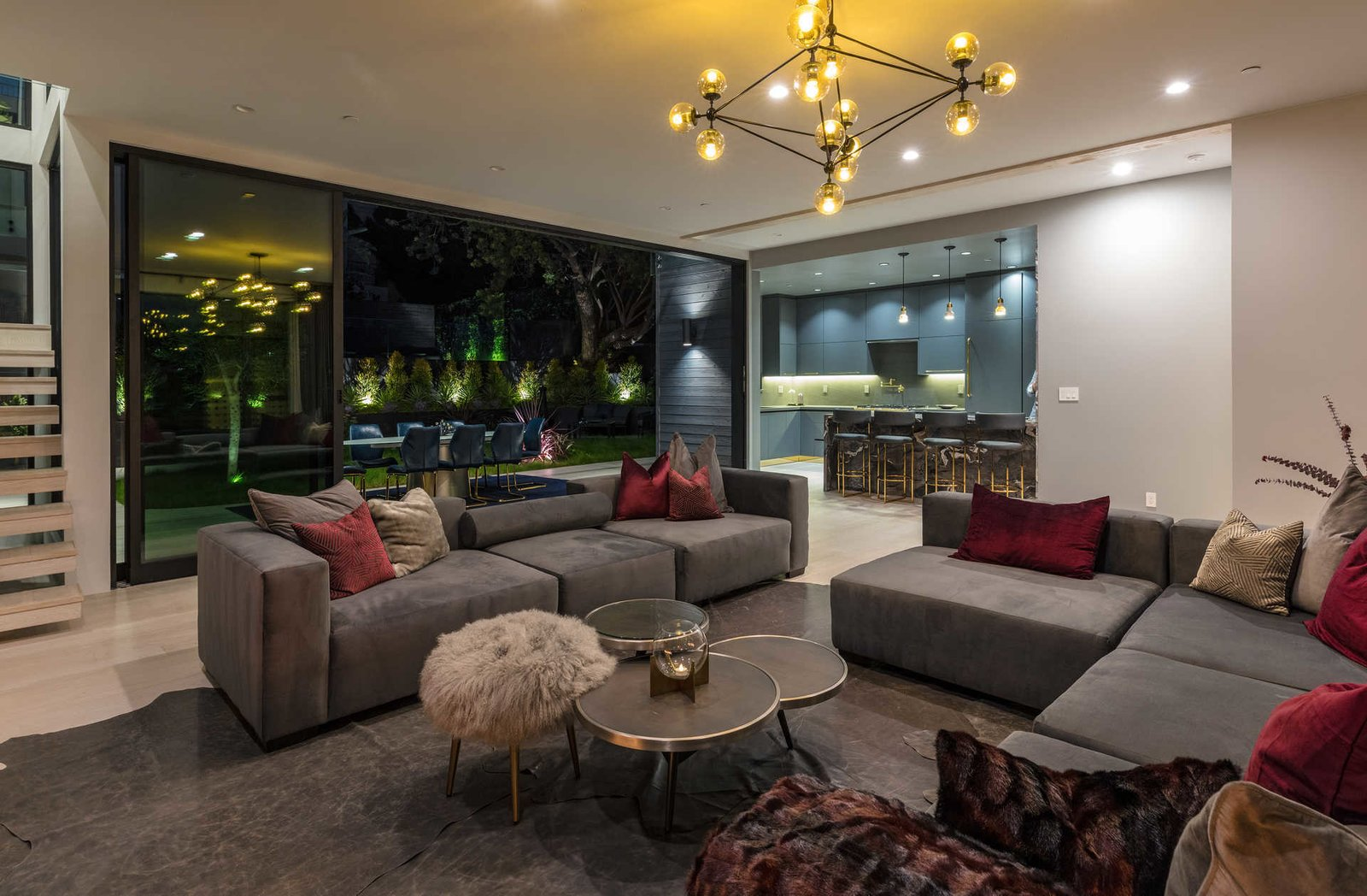 Tagged: Living Room, Sofa, Coffee Tables, Light Hardwood Floor, Ceiling Lighting, and Sectional.  Italian Modernist Home by Zillow