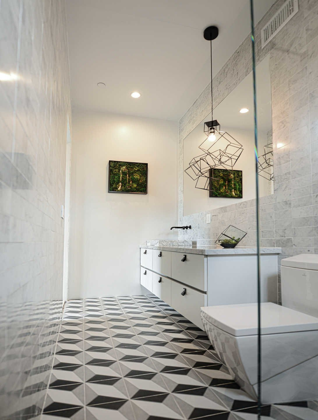Tagged: Bath Room, Two Piece Toilet, Pendant Lighting, Stone Tile Wall, Ceramic Tile Floor, and Marble Counter.  Italian Modernist Home by Zillow