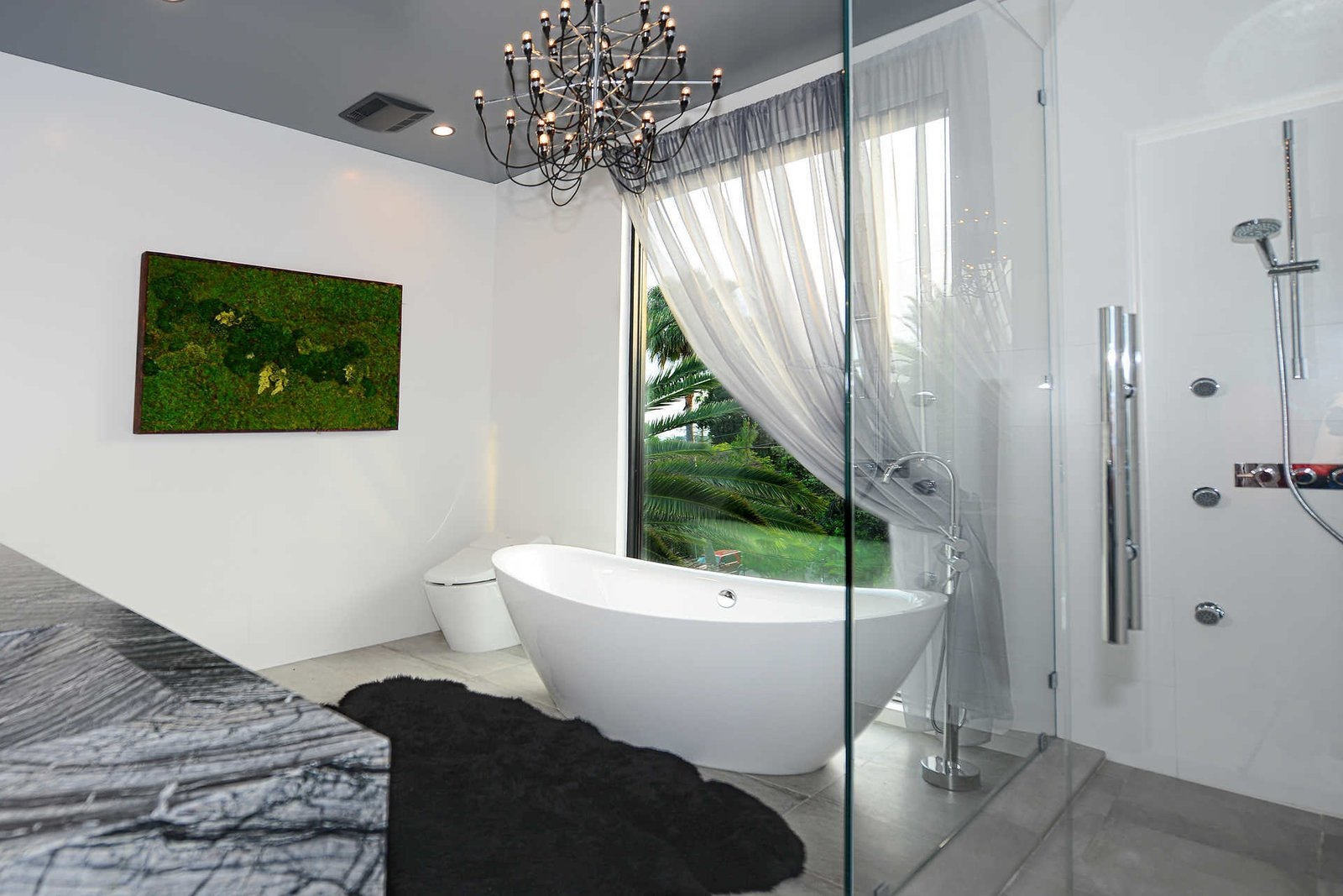 Tagged: Bath Room, Freestanding Tub, Soaking Tub, Enclosed Shower, and Corner Shower.  Italian Modernist Home by Zillow