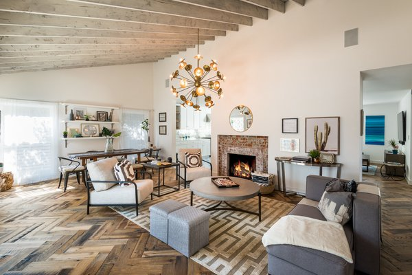 Tagged: Living Room, Medium Hardwood Floor, Chair, Sofa, and Standard Layout Fireplace.  Mid-Century Meets Boho Chic by Zillow
