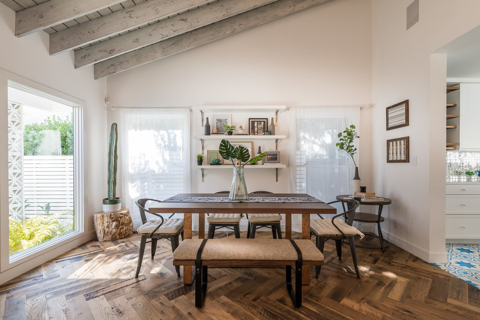 Tagged: Dining Room, Bench, Table, Medium Hardwood Floor, and Chair.  Mid-Century Meets Boho Chic by Zillow
