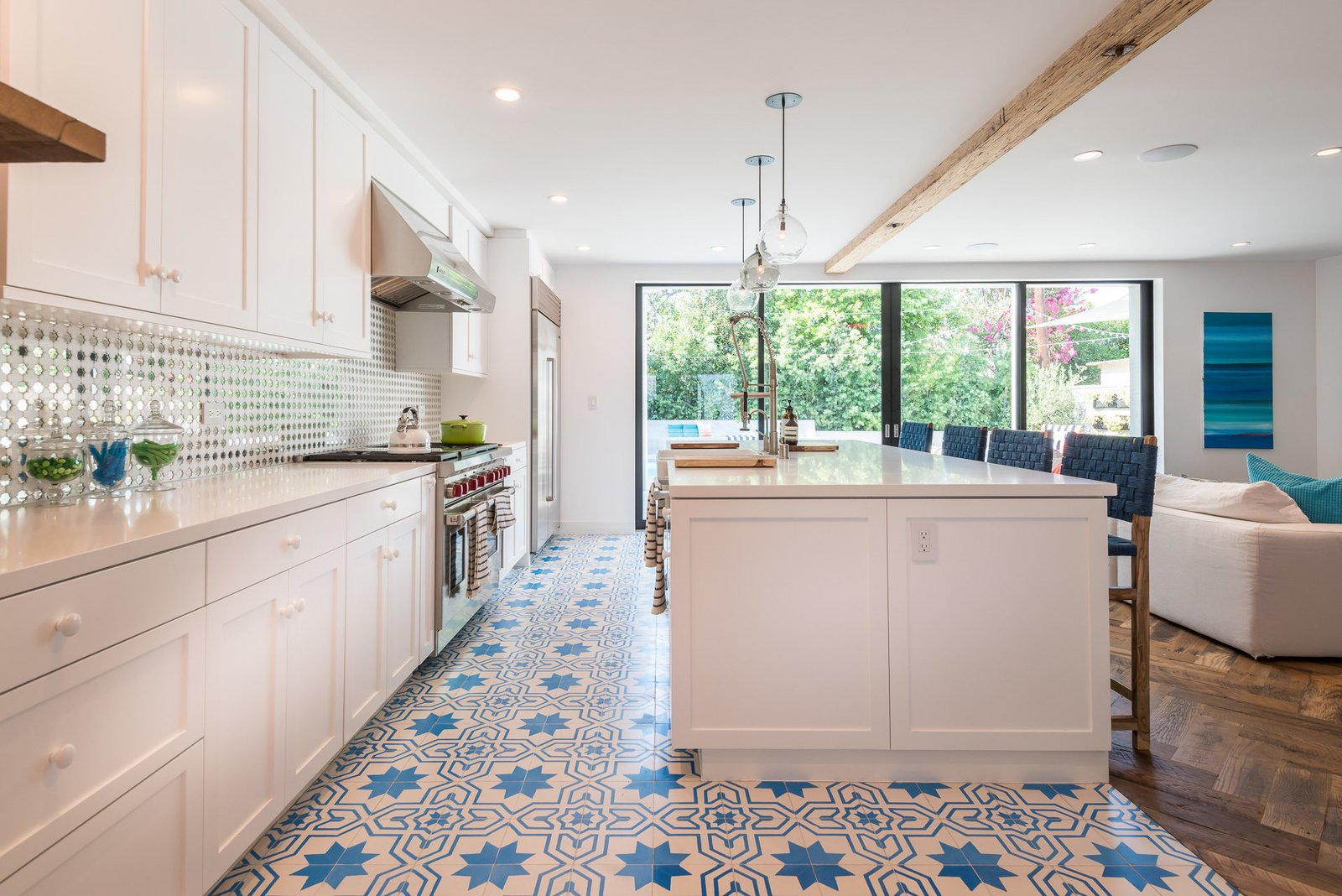 Tagged: Kitchen, White Cabinet, Pendant Lighting, and Range.  Mid-Century Meets Boho Chic by Zillow