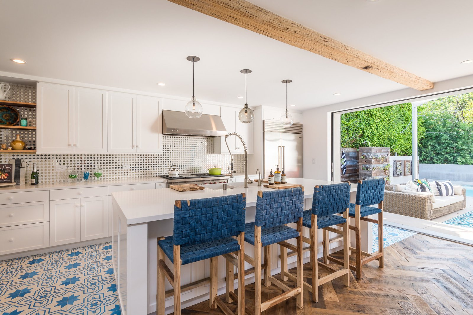 Tagged: Kitchen, White Cabinet, and Pendant Lighting. Mid-Century Meets Boho Chic by Zillow