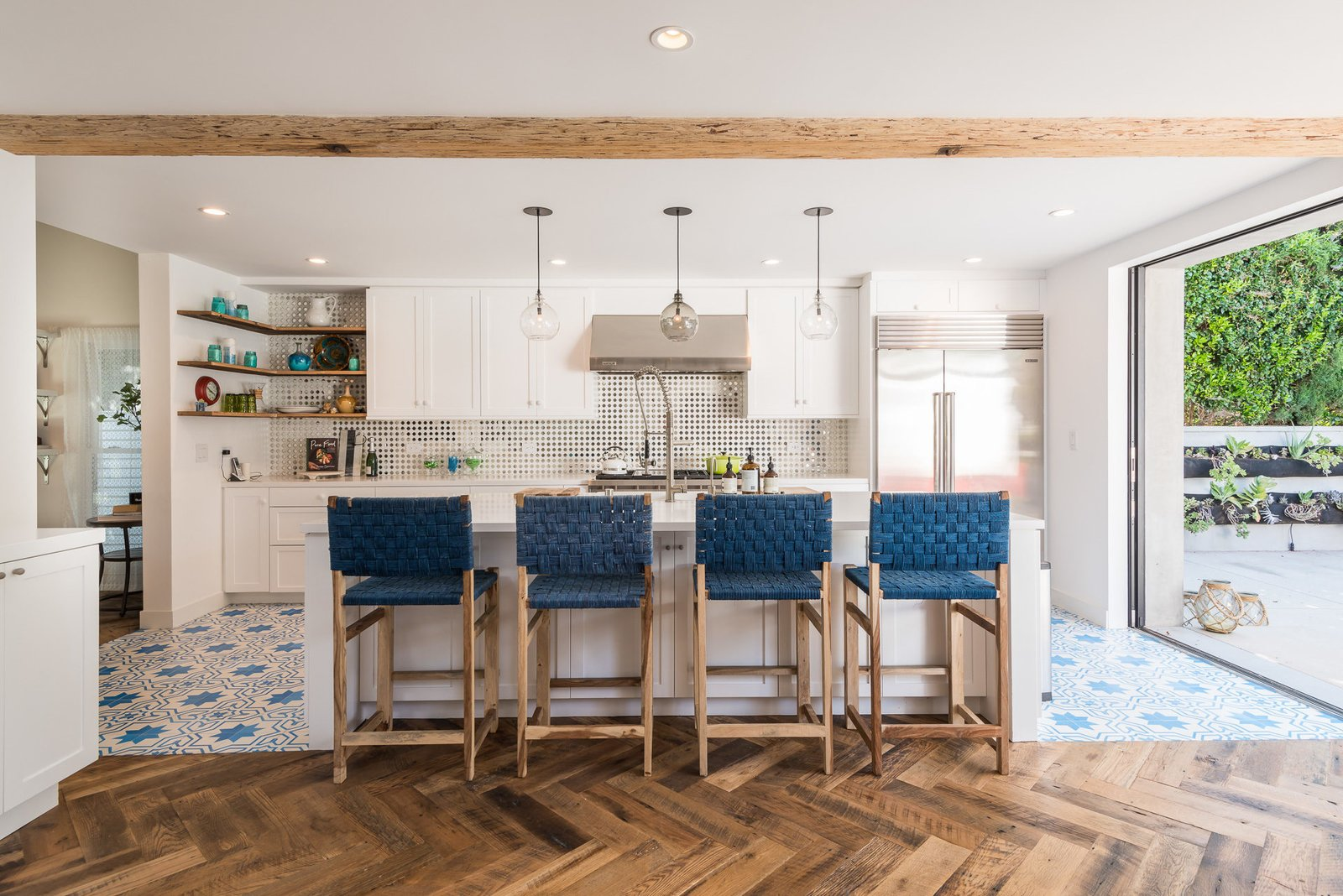 Tagged: Kitchen, Refrigerator, Range Hood, White Cabinet, and Medium Hardwood Floor.  Mid-Century Meets Boho Chic by Zillow