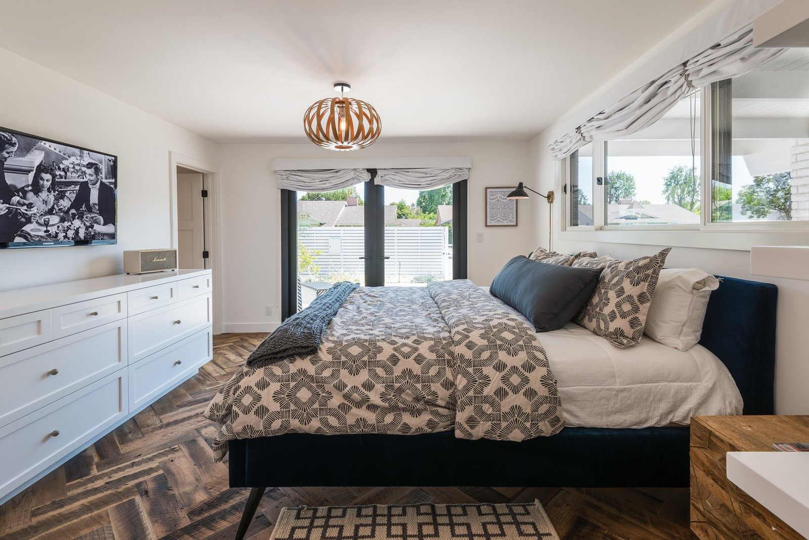 Tagged: Bedroom, Bed, and Medium Hardwood Floor.  Mid-Century Meets Boho Chic by Zillow