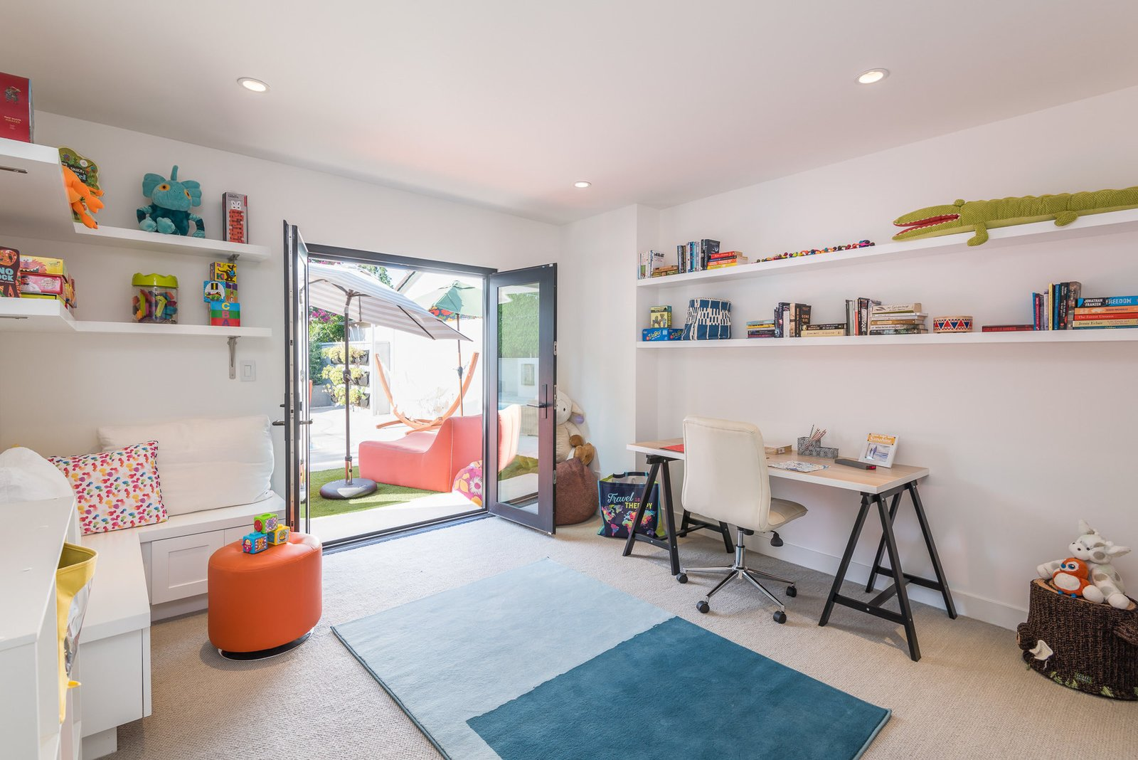 Tagged: Office, Craft Room, Chair, Desk, and Shelves.  Mid-Century Meets Boho Chic by Zillow