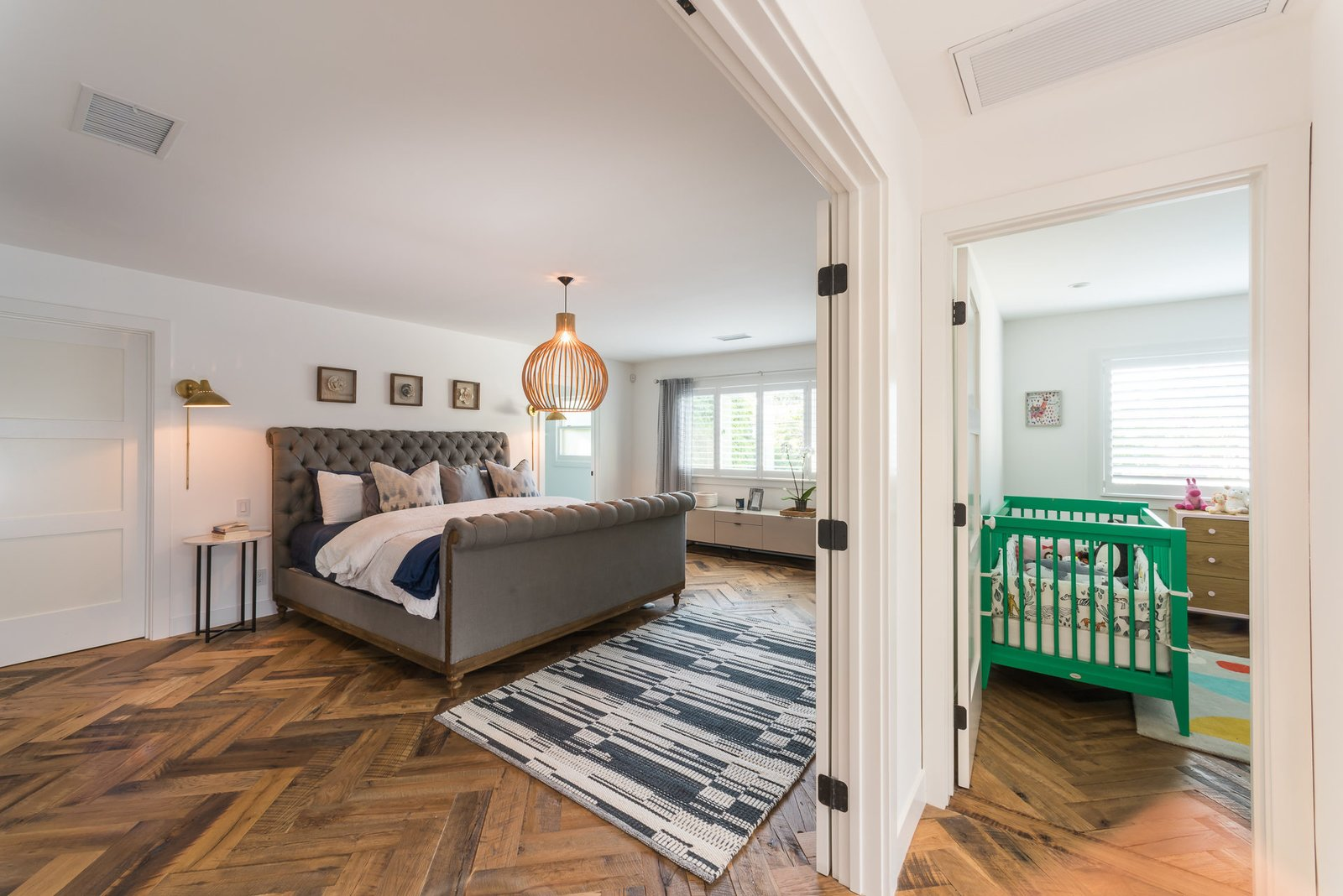 Tagged: Bedroom, Medium Hardwood Floor, and Bed. Mid-Century Meets Boho Chic by Zillow